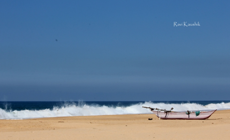Hikkaduwa beach sri lanka waves boat